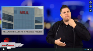 Sign 1 News with Jethro Wooddall - NRA lawsuit claims its in financial trouble - (ASL - 8.5.18)