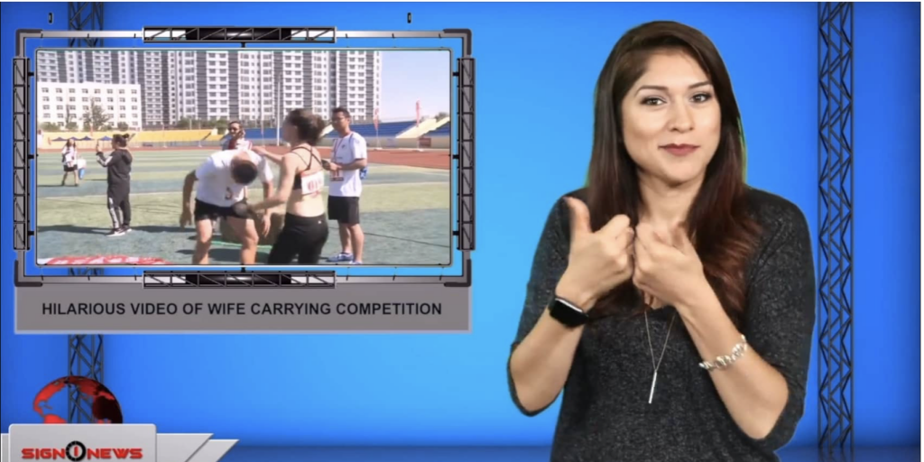 Sign1News anchor Crystal Cousineau - Hilarious video of wife carrying competition (ASL - 9.7.19)